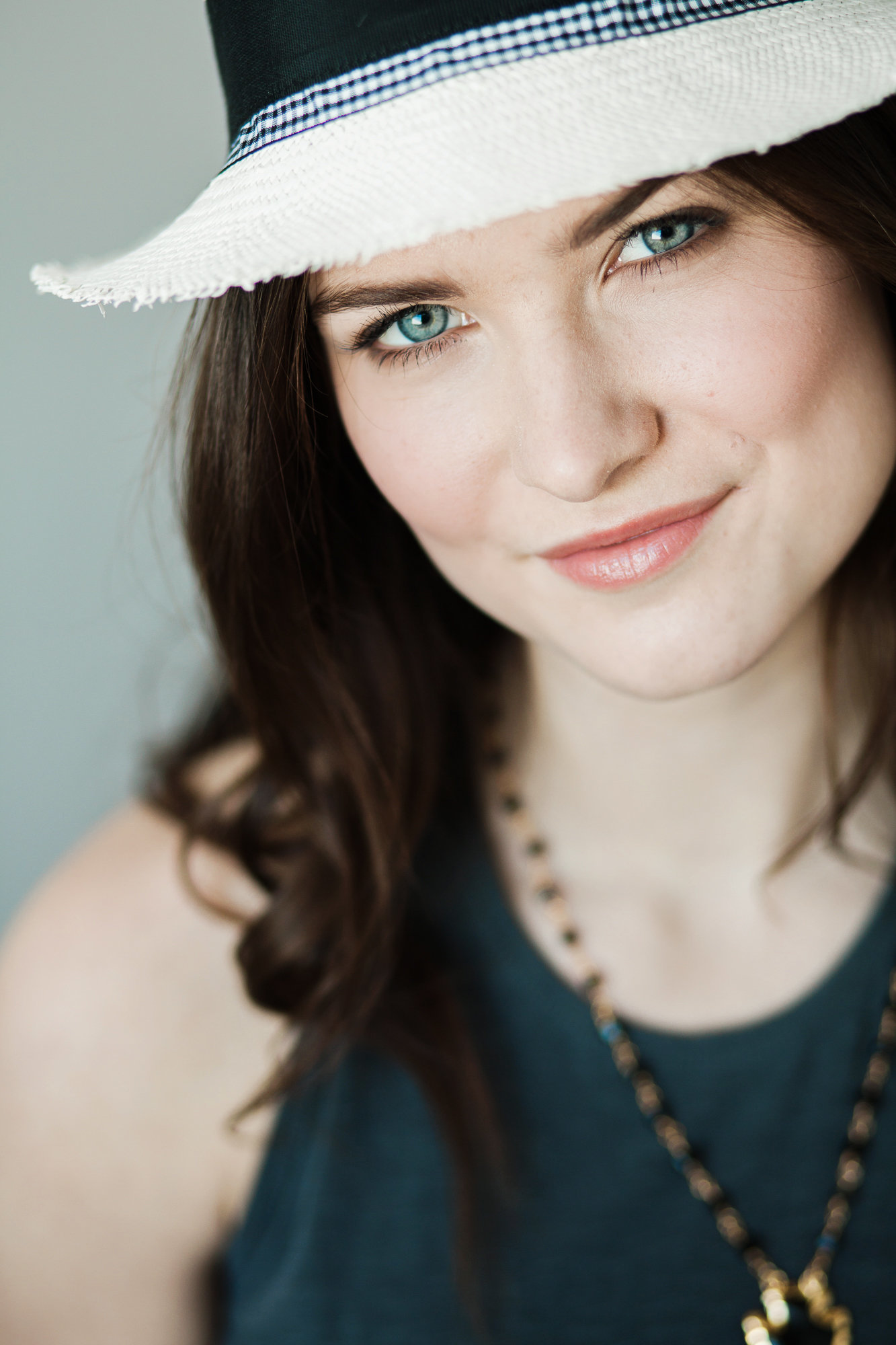 headshot of a brunette makeup by Beke Beau