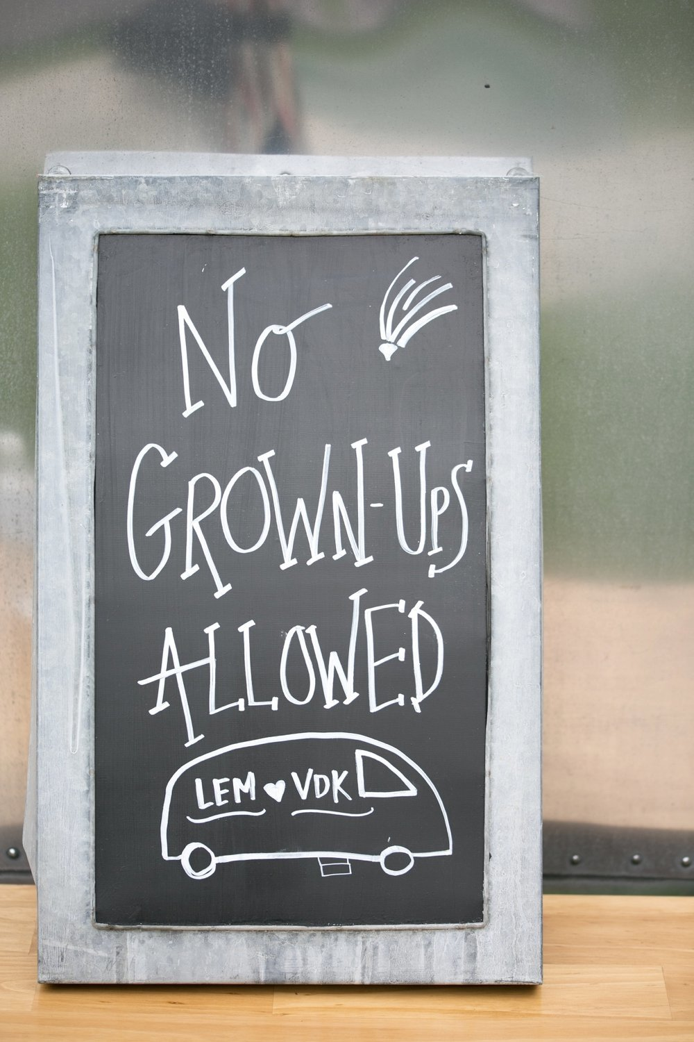 No grownups allowed chalkboard sign at wedding. Great for a kids play area!