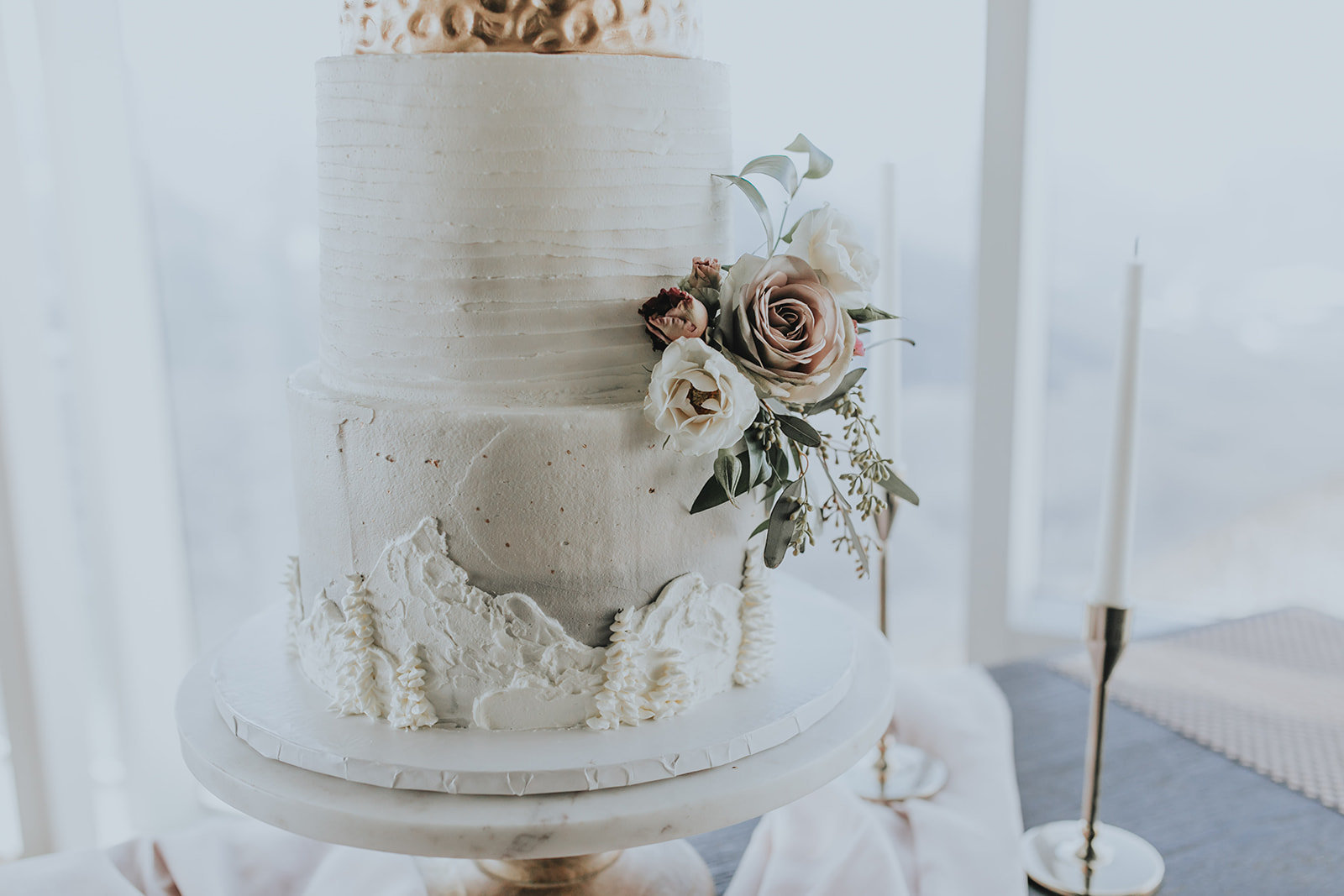 beautiful wedding cake with a mountain theme made by Bake My Day