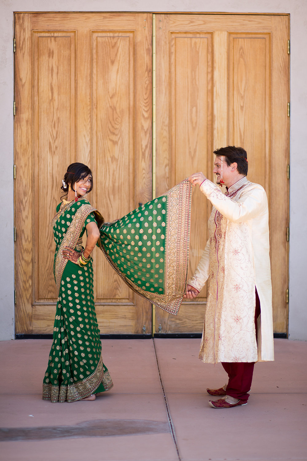 Fun pose for a an Indian bride in a Sari