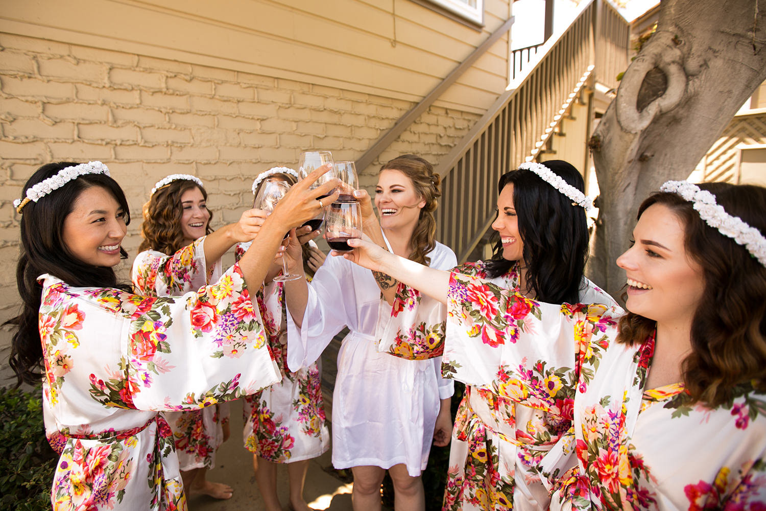 bride laughing with bride maids getting ready