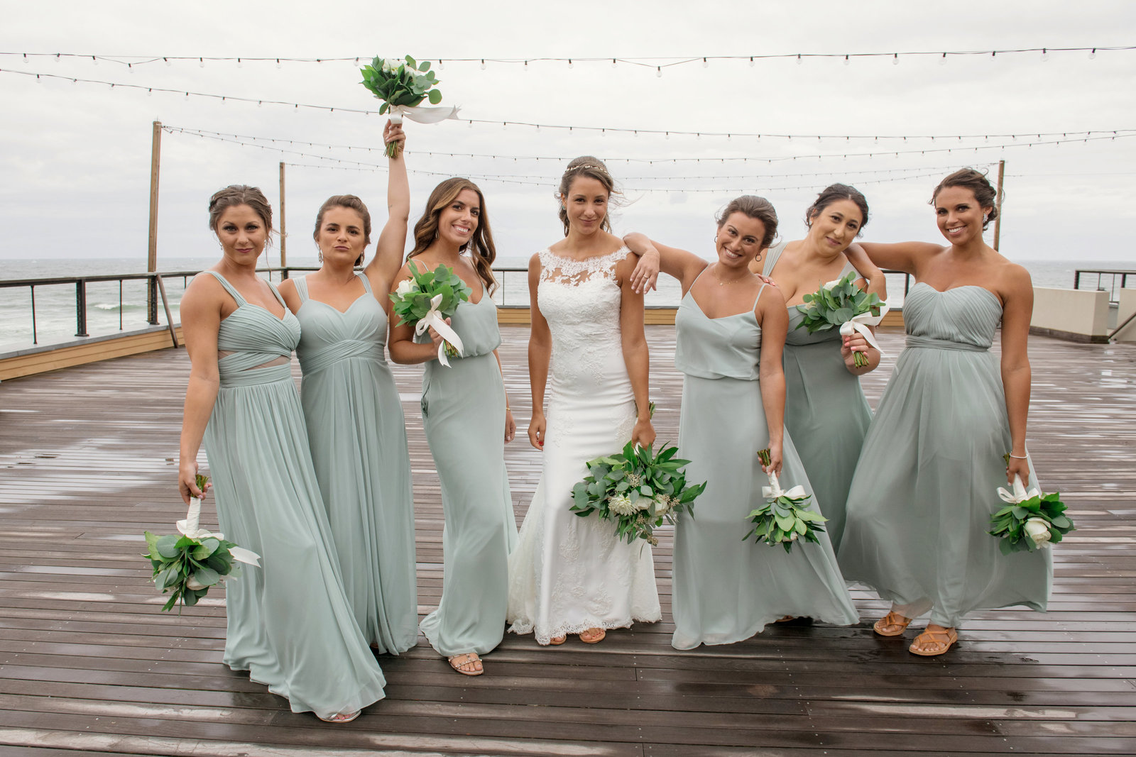 photo of bridesmaids with bride on boardwalk from  Gurneys Montauk Resort wedding