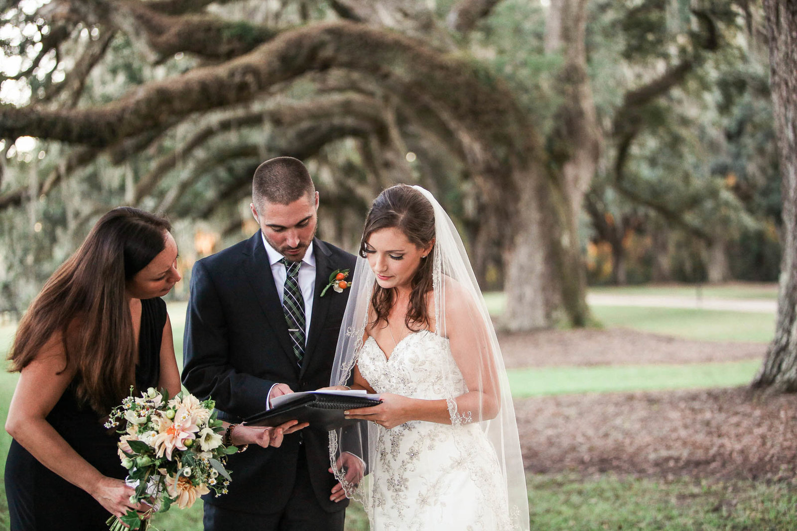 Bride and groom sign marriage license at Avenue of Oaks, Boone Hall Plantation, Charleston, South Carolina