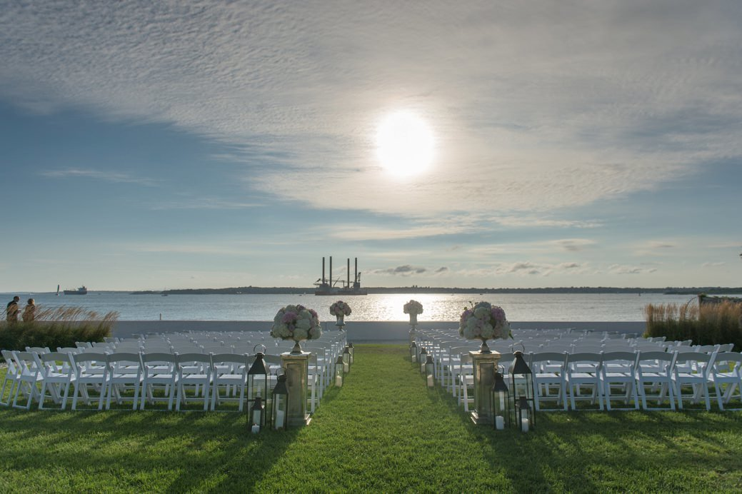 Ceremony on the lawn at sunset at Belle Mer in Newport, RI
