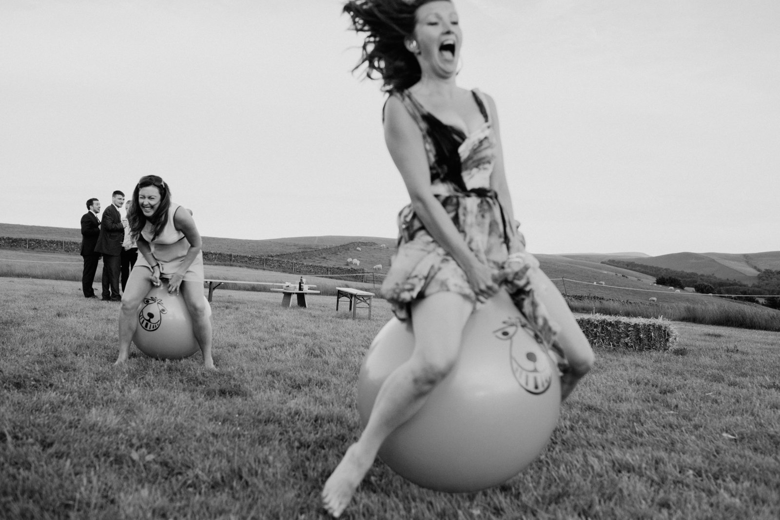 Festival style wedding with bouncy hoppers. Alternative documentary wedding photographer