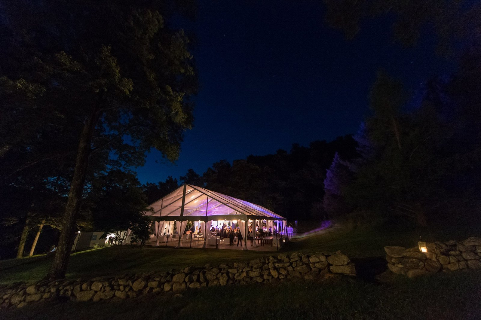 Clear top wedding tent with crystal chandeliers for home wedding in Washington, CT