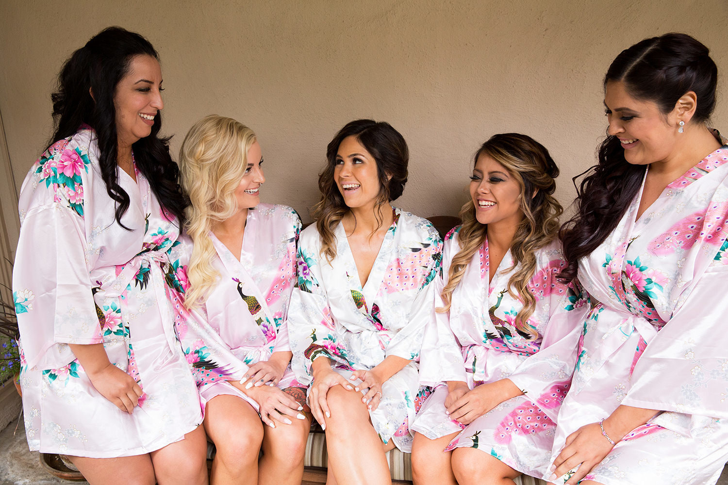 Cute candid moment with the bridesmaids in robes