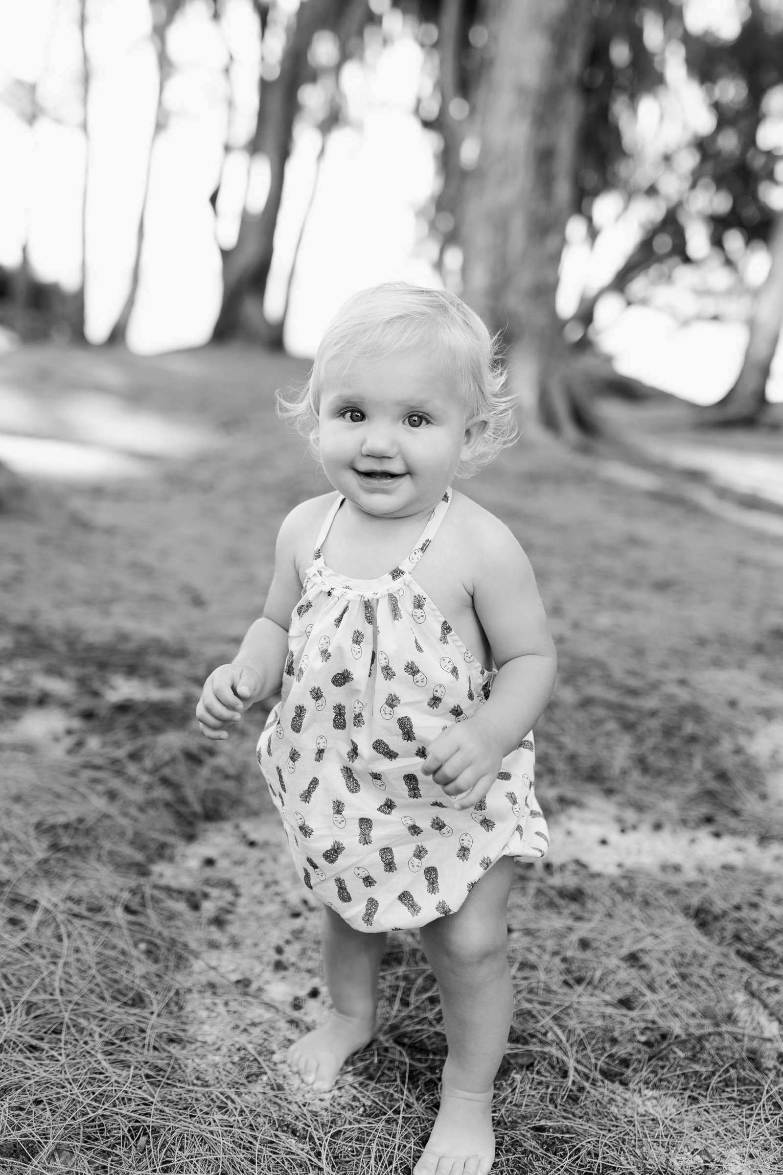 Oahu, Hawaii Lifestyle Photographer - Lifestyle Photography - Brooke Flanagan Photography - Little girl at the beach in black and white