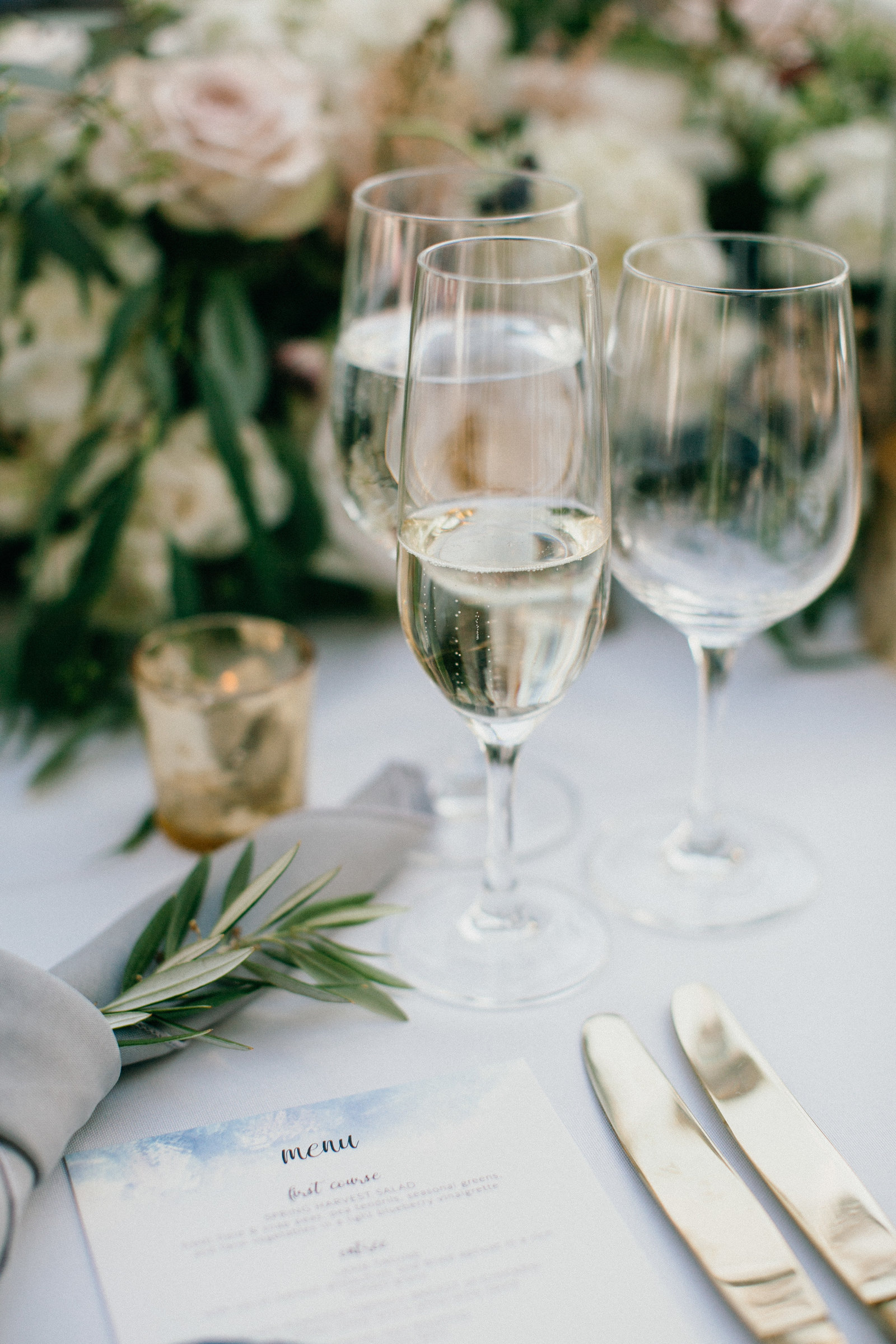 Elegant wedding details displayed on reception tables .