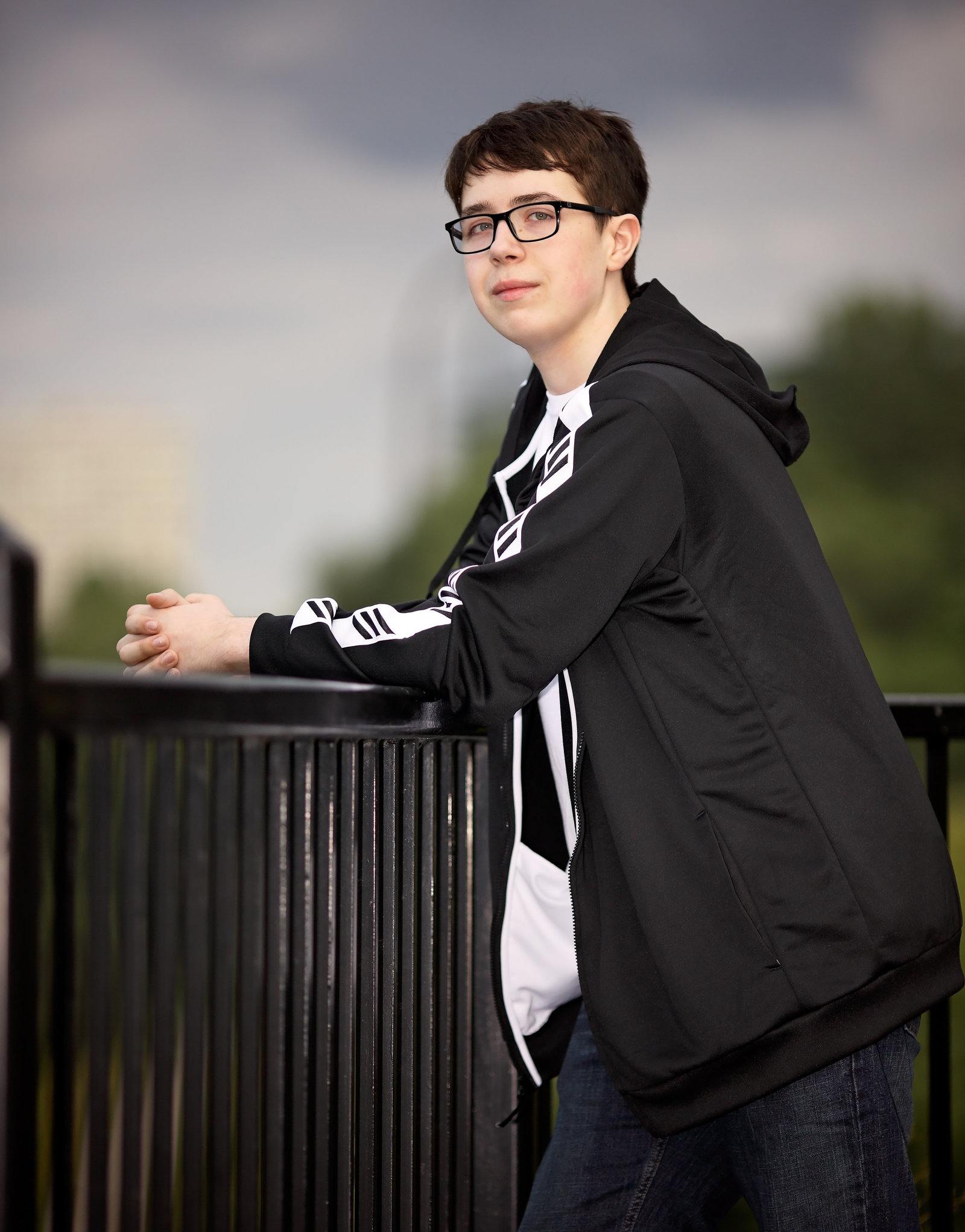 Senior portraits of guy on railing in Savannah GA