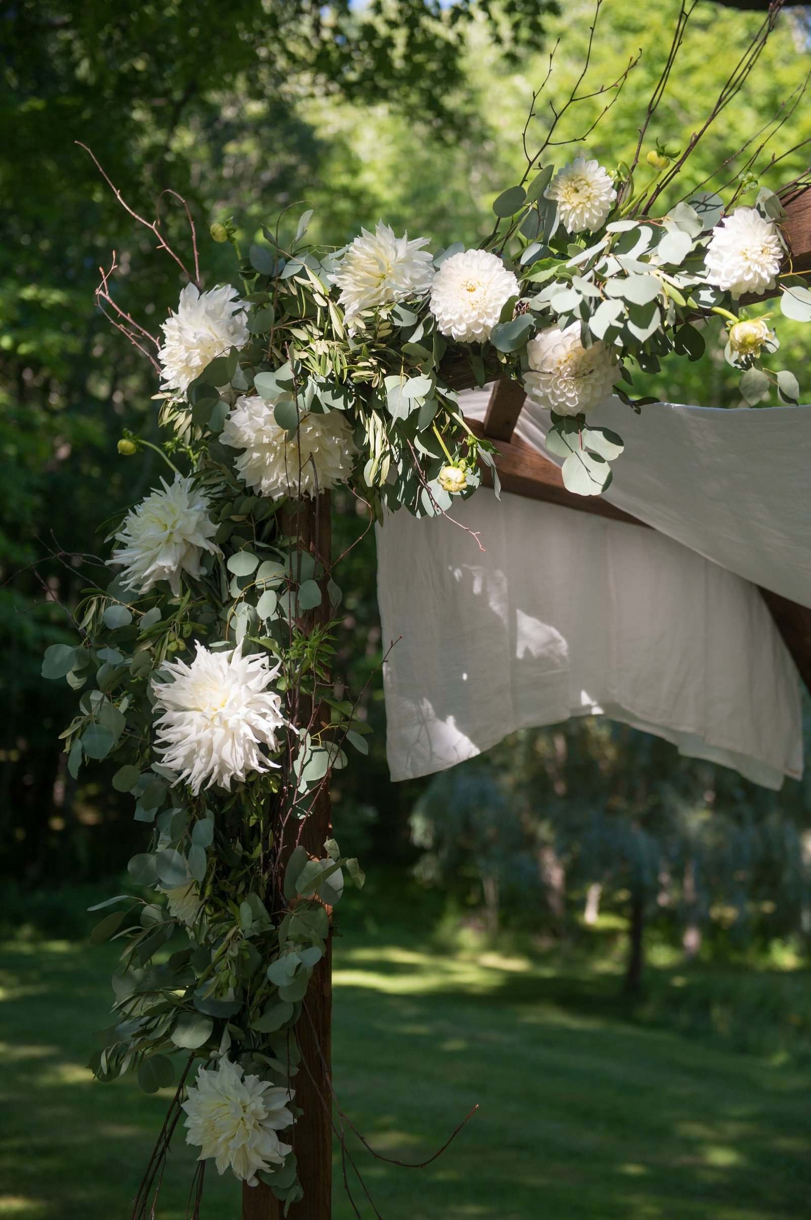 Gorgeous outdoor home wedding ceremony with white chuppah in Washington, CT