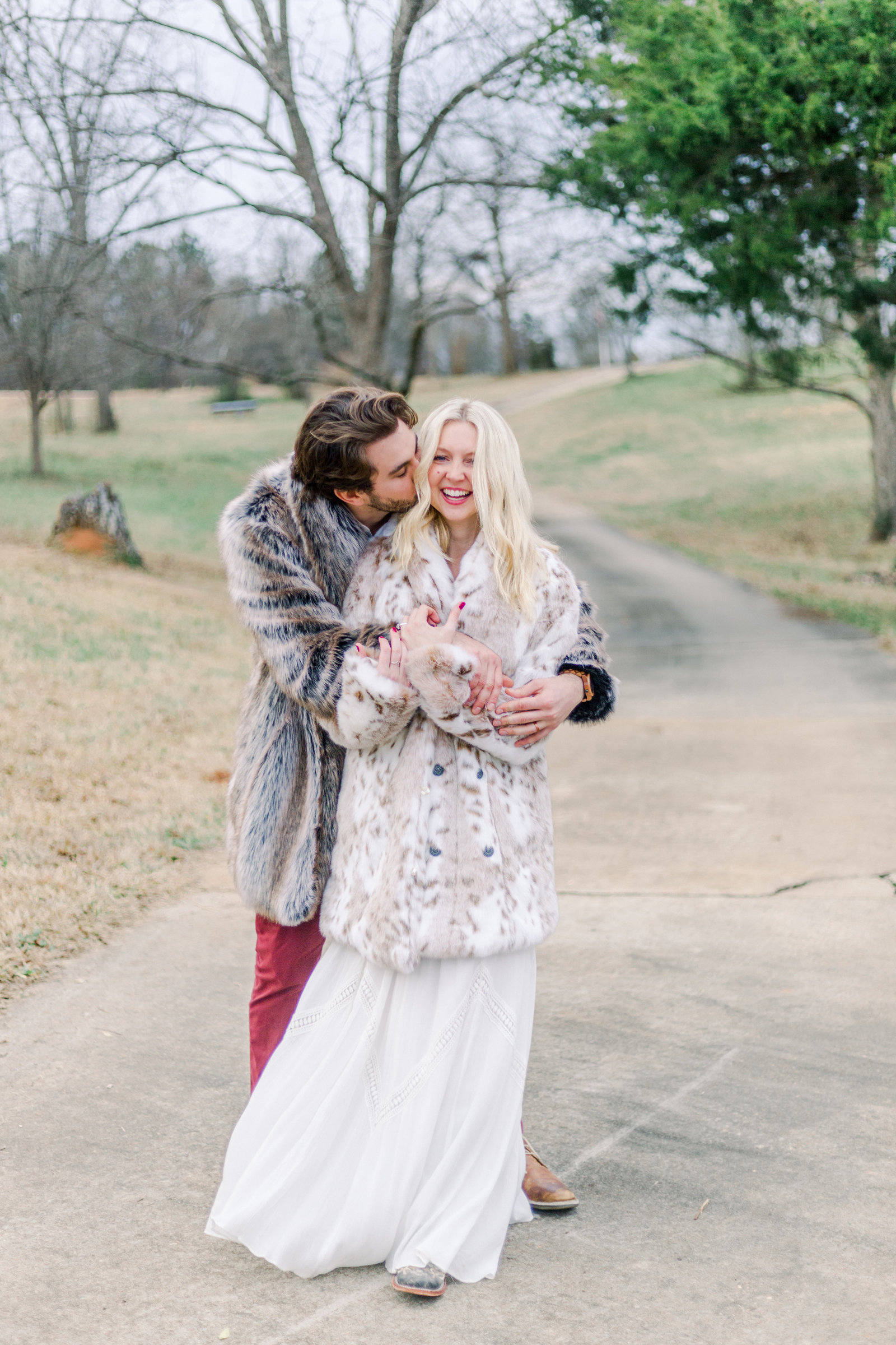 Couple smiling and hugging captured by Staci Addison Photography