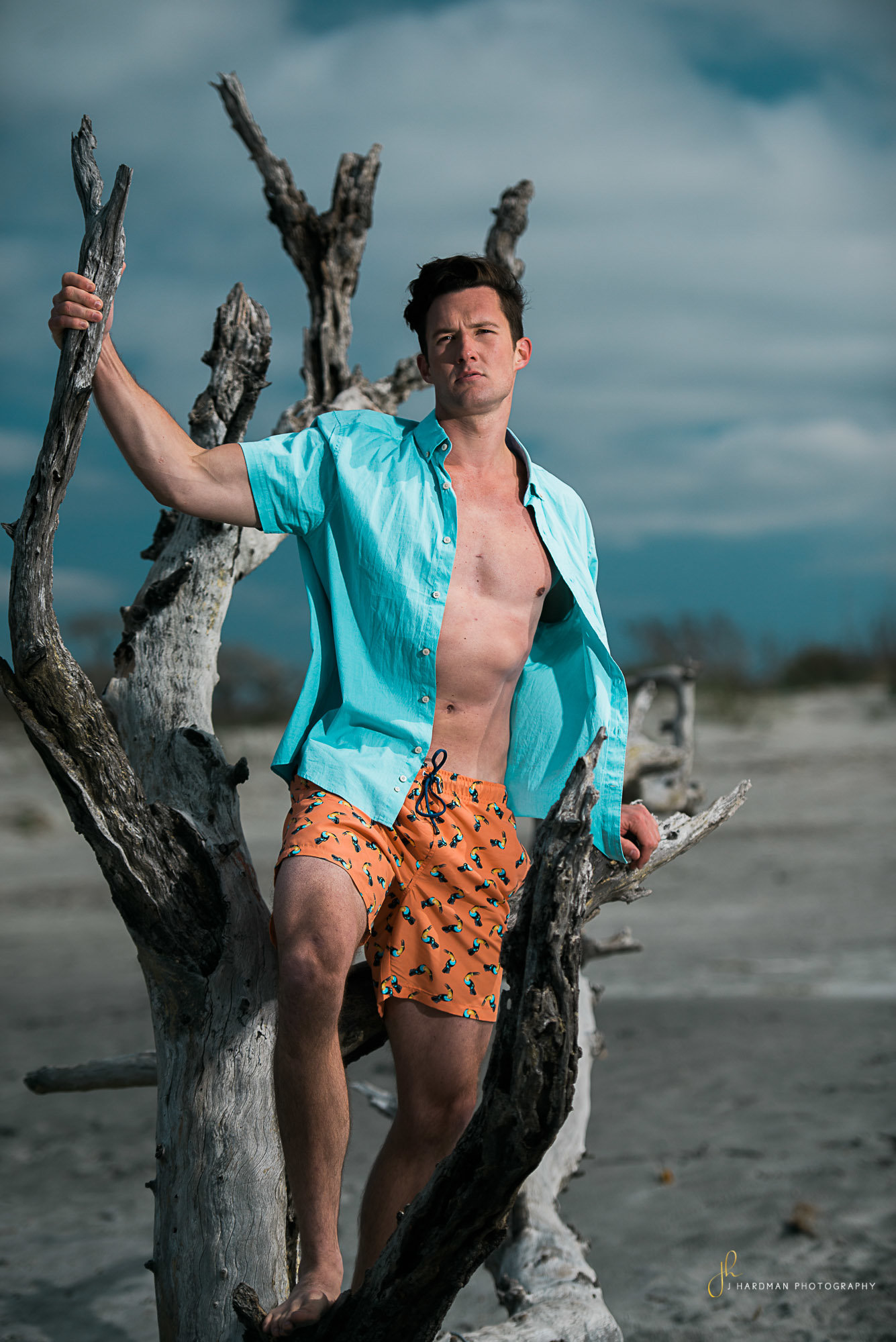 Nature Male model portrait on beach by Hardman Portraits
