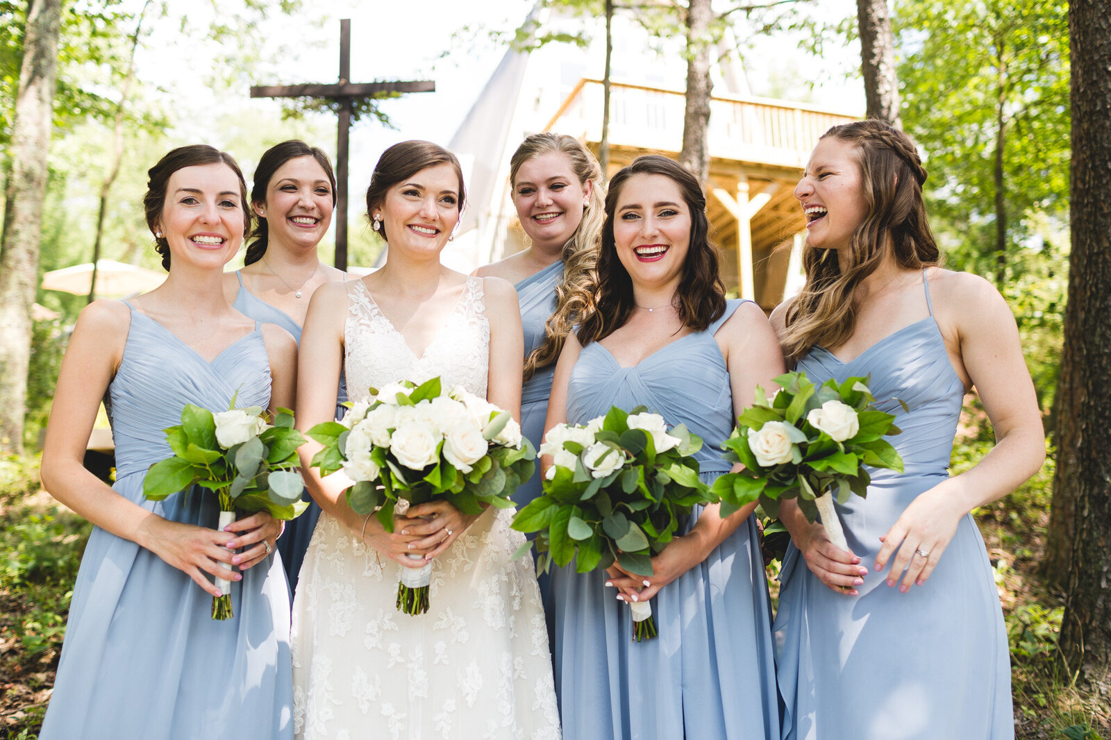 micro weding bridal party laughing with blue dresses and flowers ohio