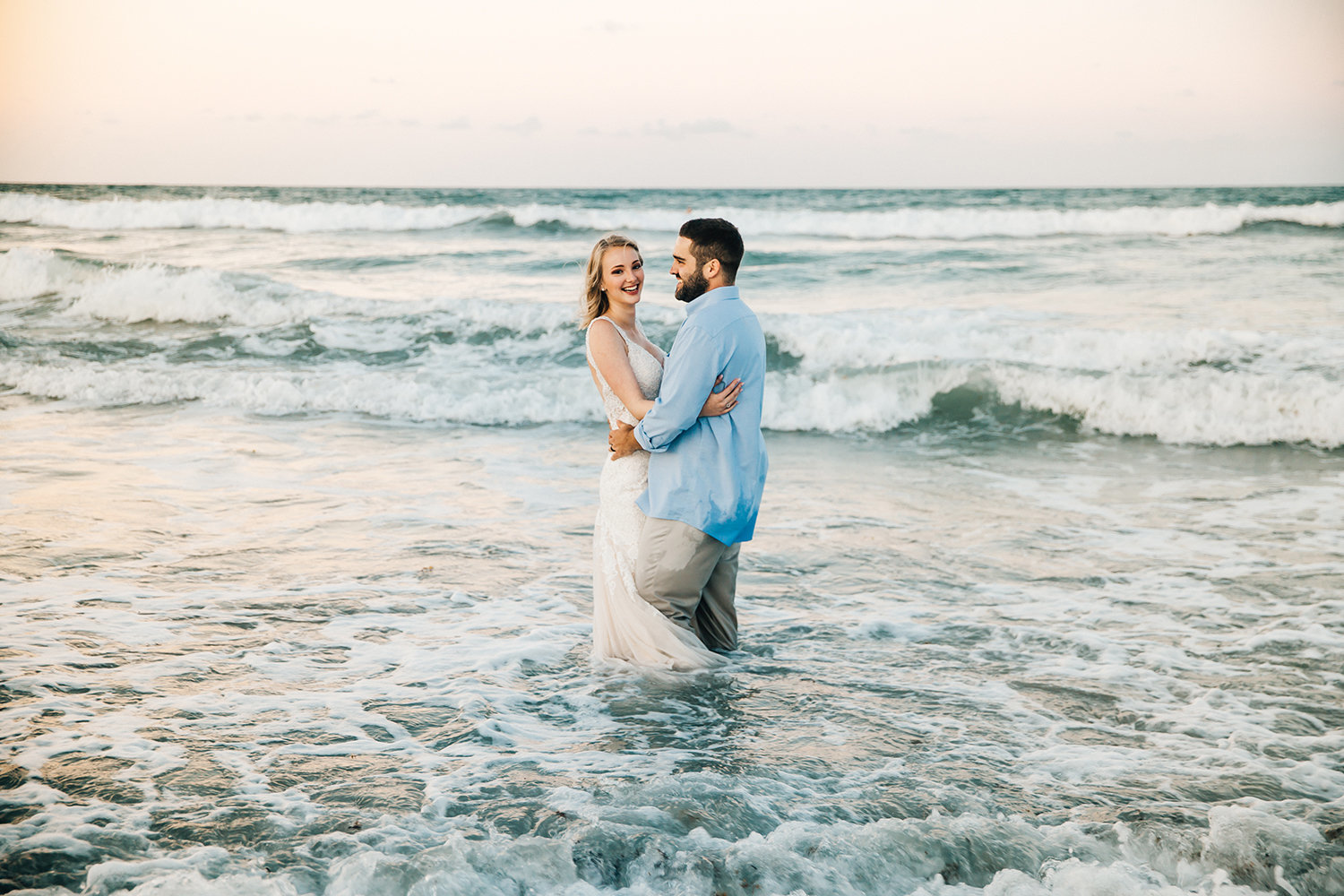 bride-groom-playing-in-ocean-melbourne-florida