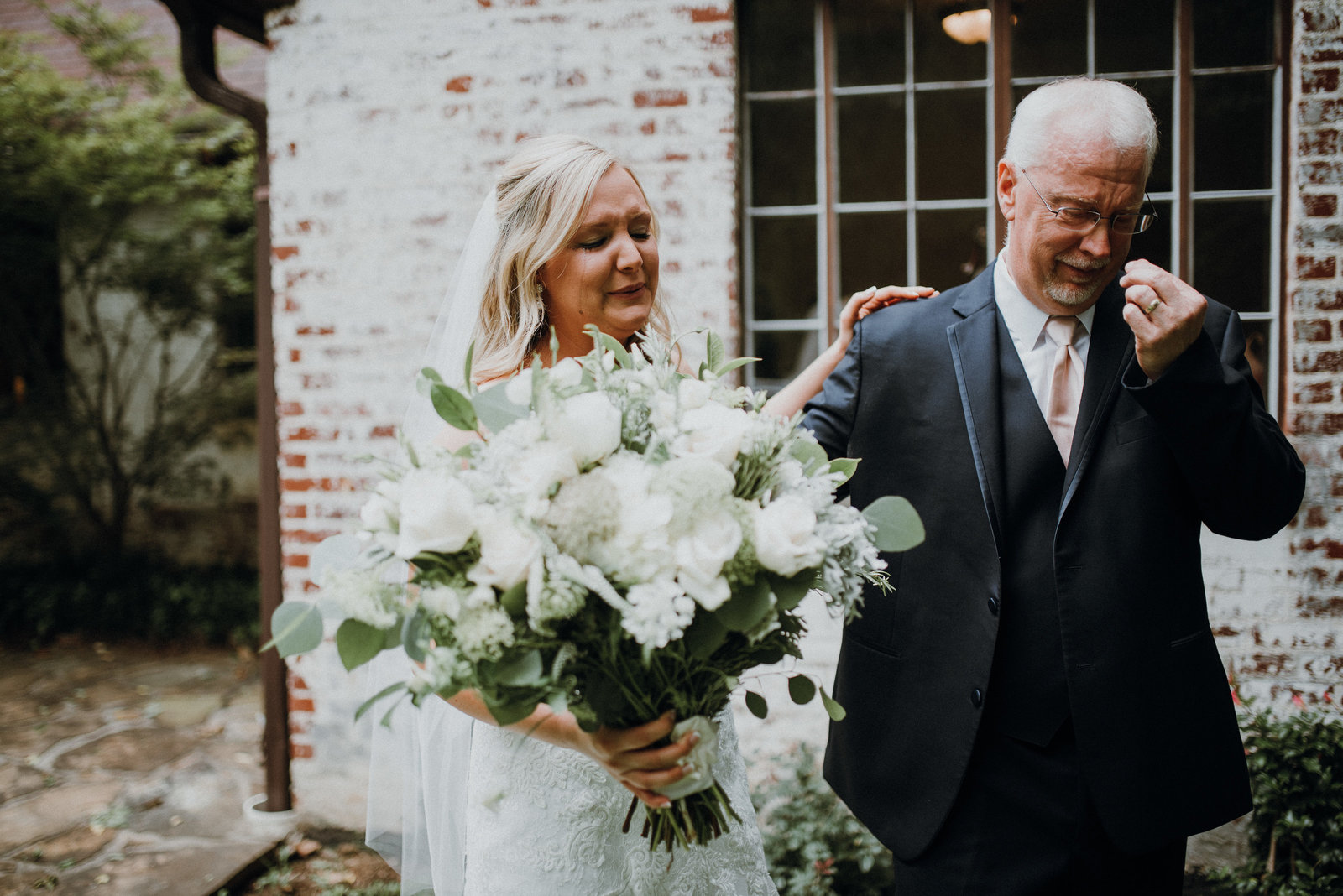 Bride and her father share a first look at  her Pratt Place Inn and Barn, Fayetteville AR wedding