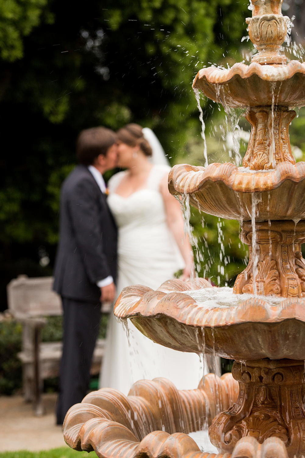 fountain with bride and groom