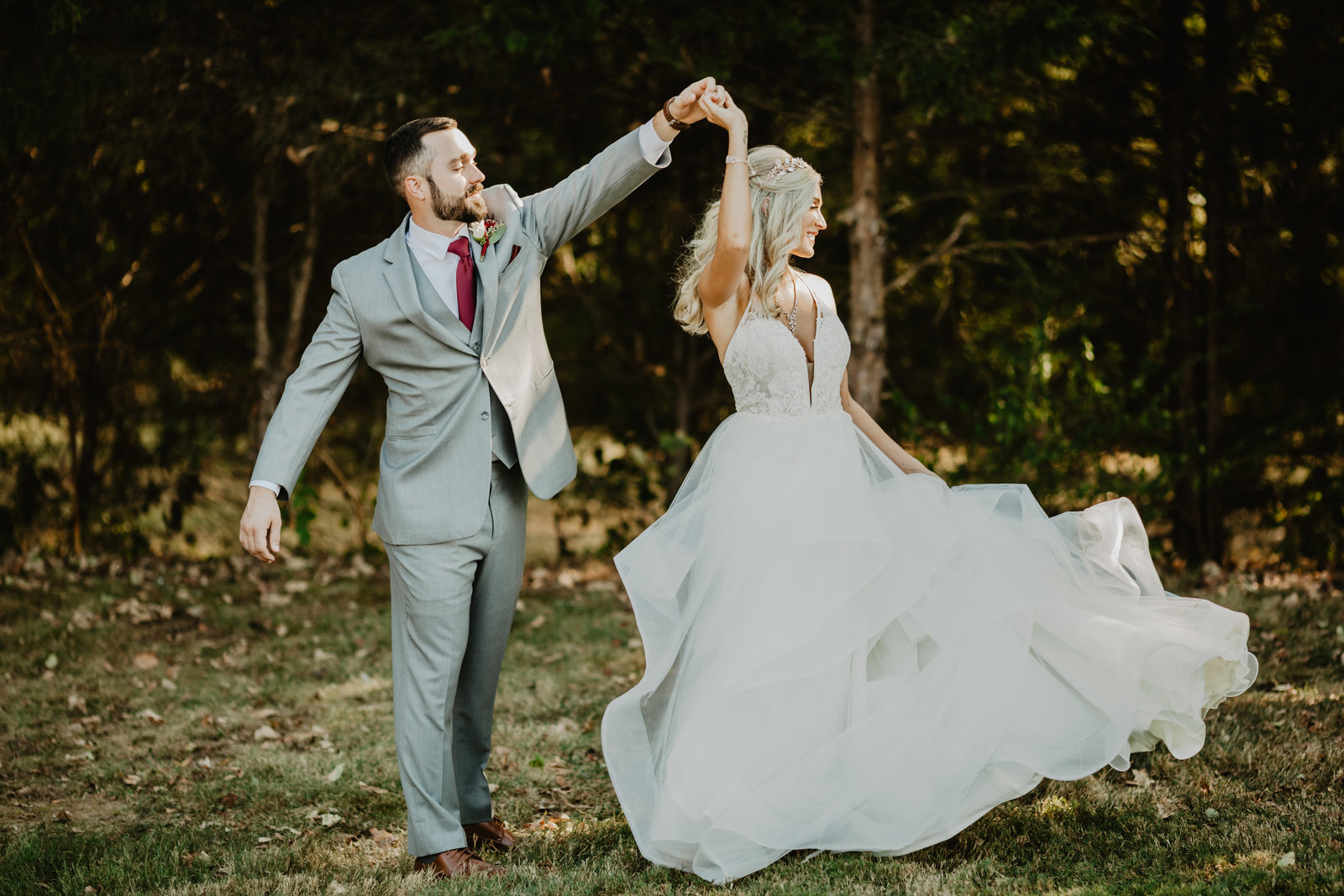 Groom spins Bride with perfect twirl at private residence