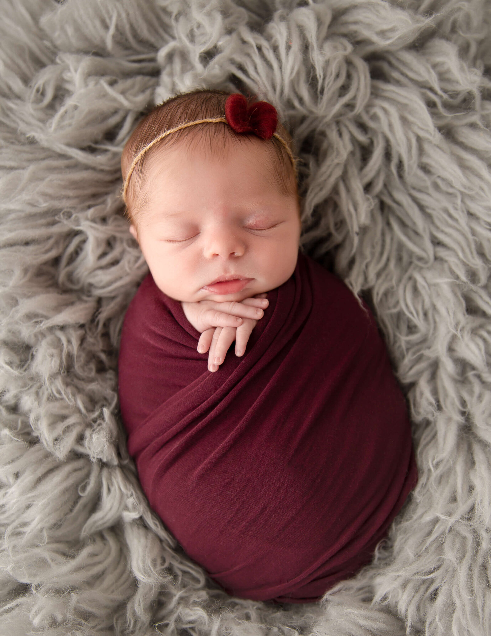Precious newborn girl at our studio in Rochester, NY.