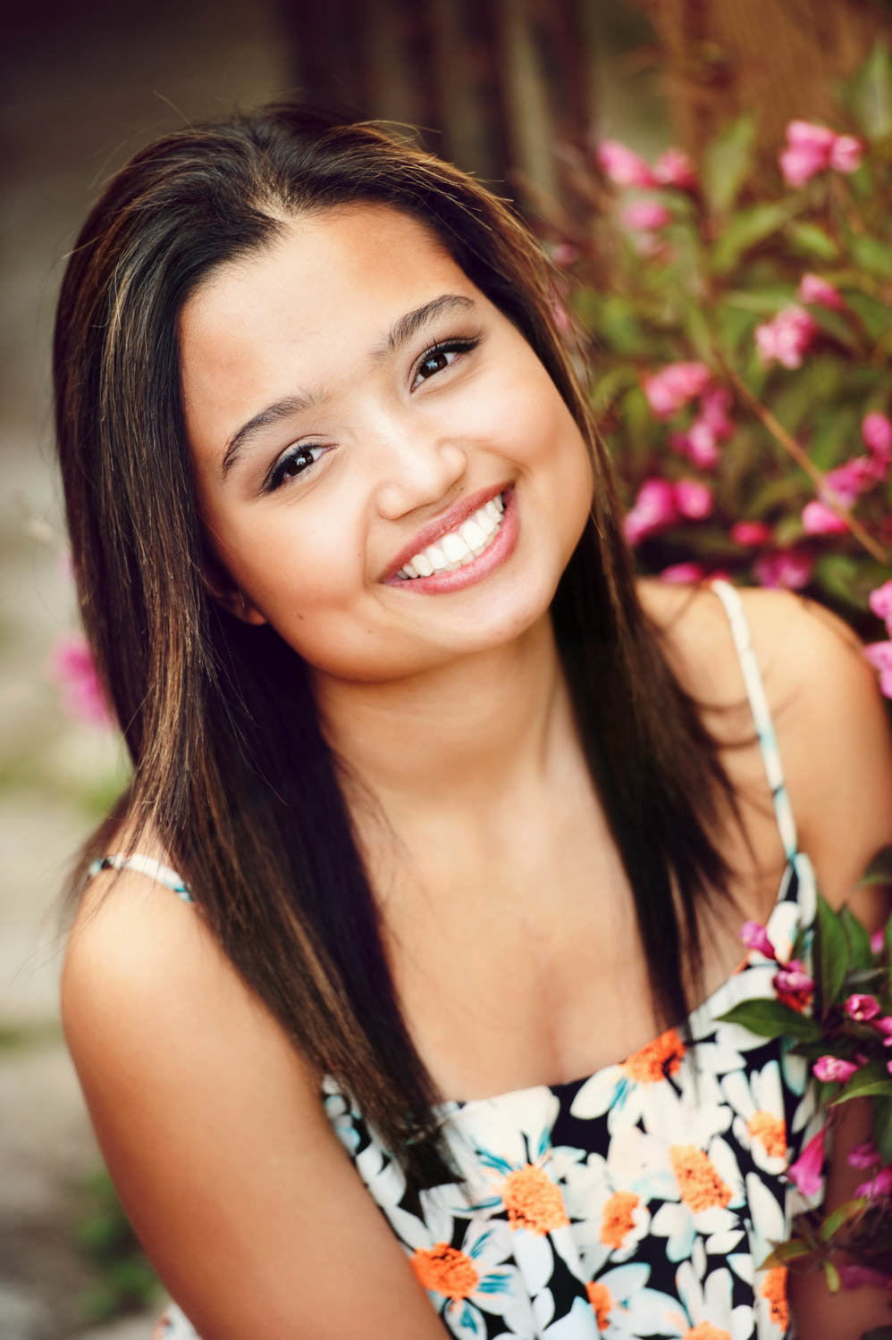 Senior picture of Asian girl with flowers