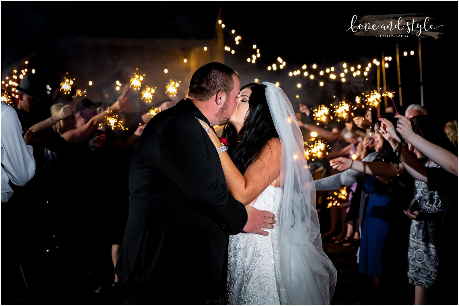 Bride and Groom kissing with sparklers The Barn at Chapel Creek, Sarasota Florida