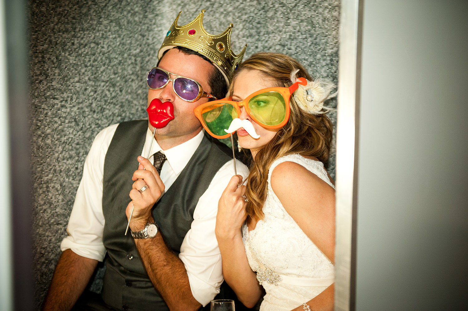 bride and groom in photo booth at hilton mission bay