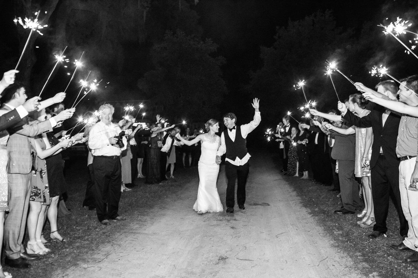 Bride and groom run down sparkler exit, Oakland Plantation, Mt Pleasant, South Carolina
