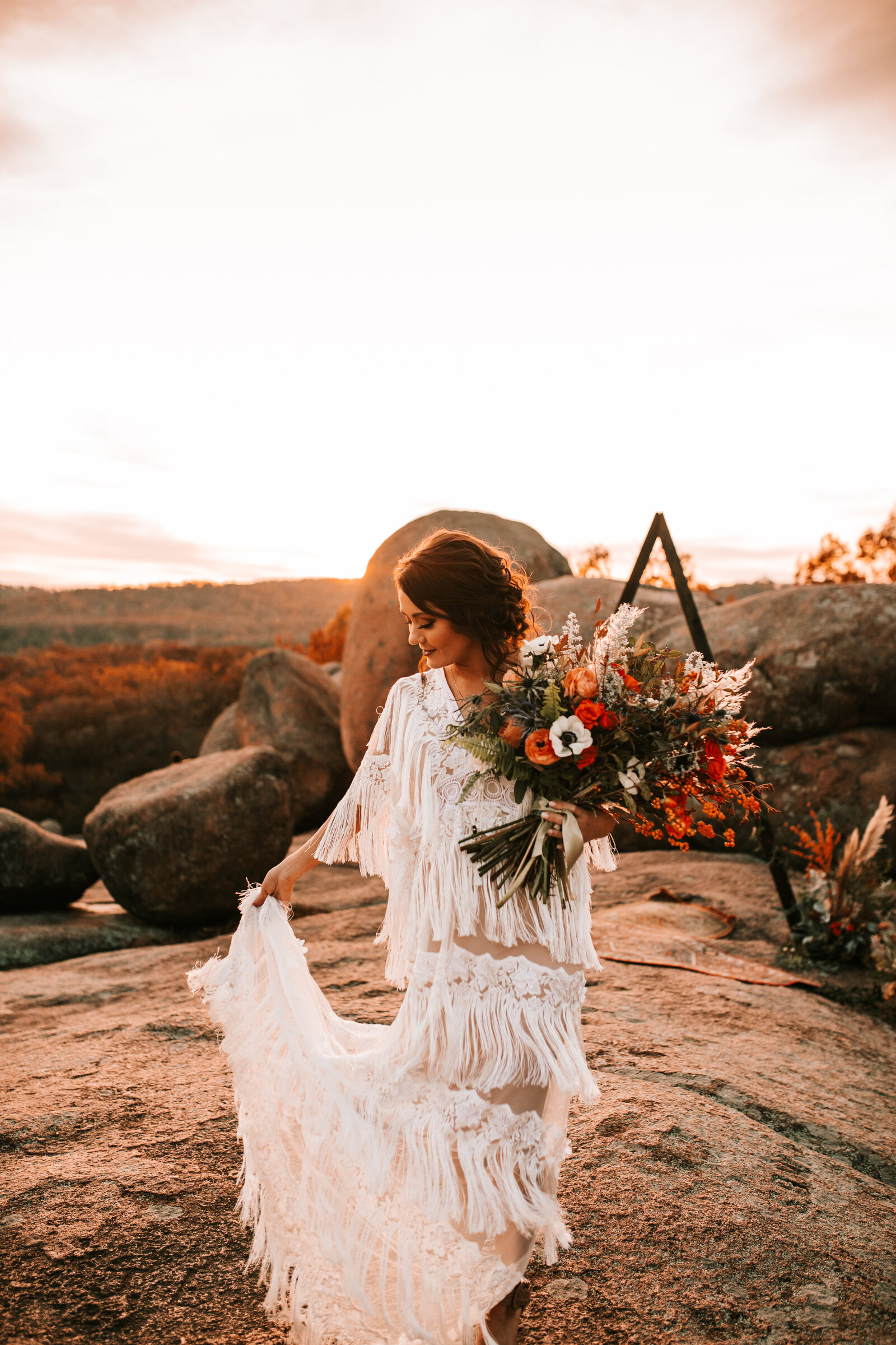 boho elopement with wife in a boho vibe dress on large rocks