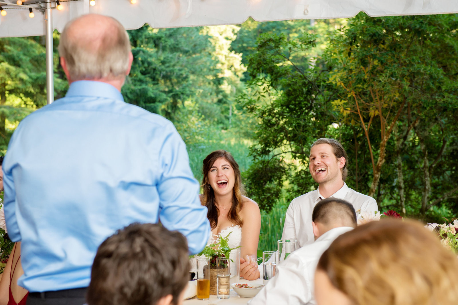 father of bride gives funny toast during reception