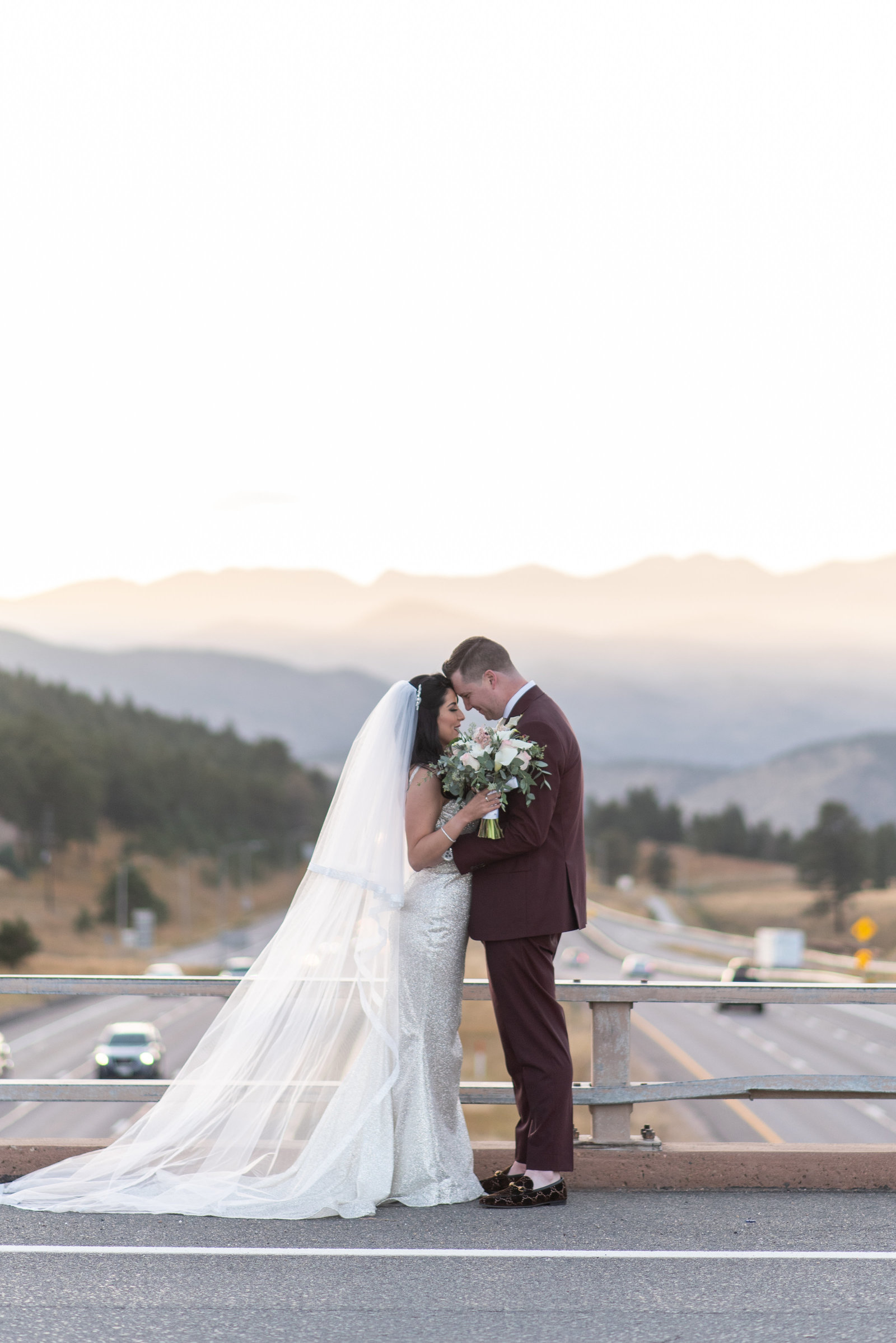 Bride and groom kissing on Genesee Bridge at sunset