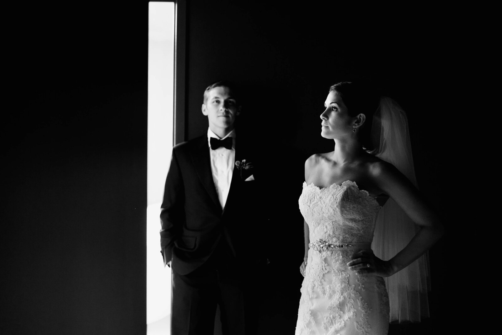 bride and groom in window light