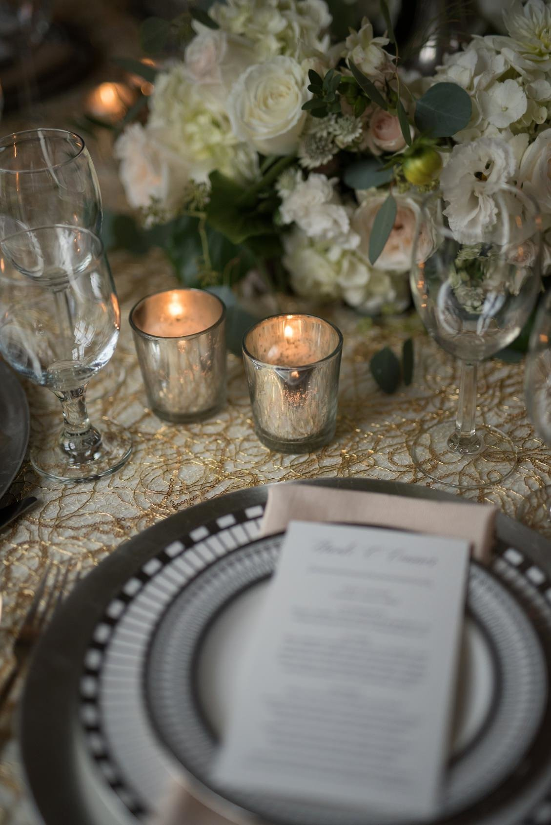 Classic wedding tablescape and placesetting in gold, champagne, silver, white and blush