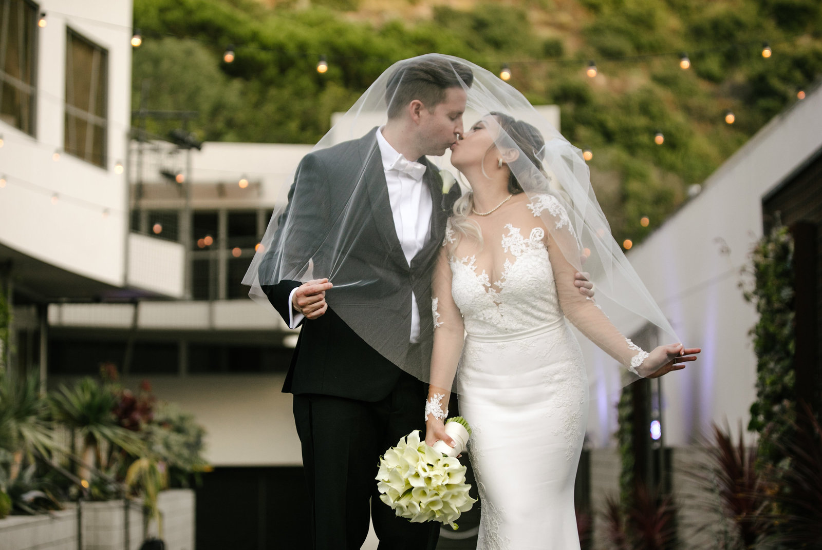 bride and groom kissing at seven degrees wedding in laguna beach