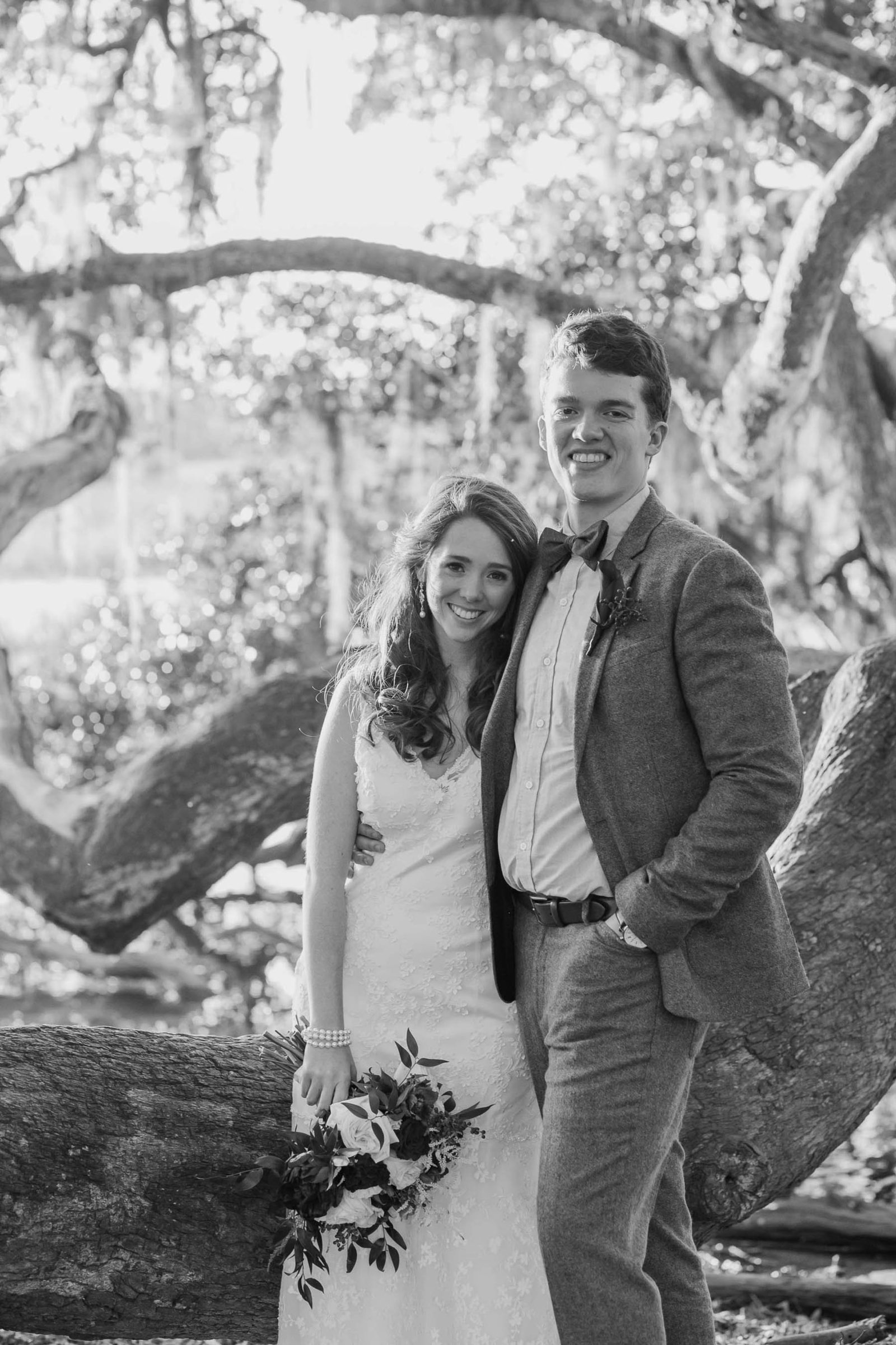 Bride and groom stand in oak tree with spanish moss, Boone Hall Plantation, Charleston, South Carolina