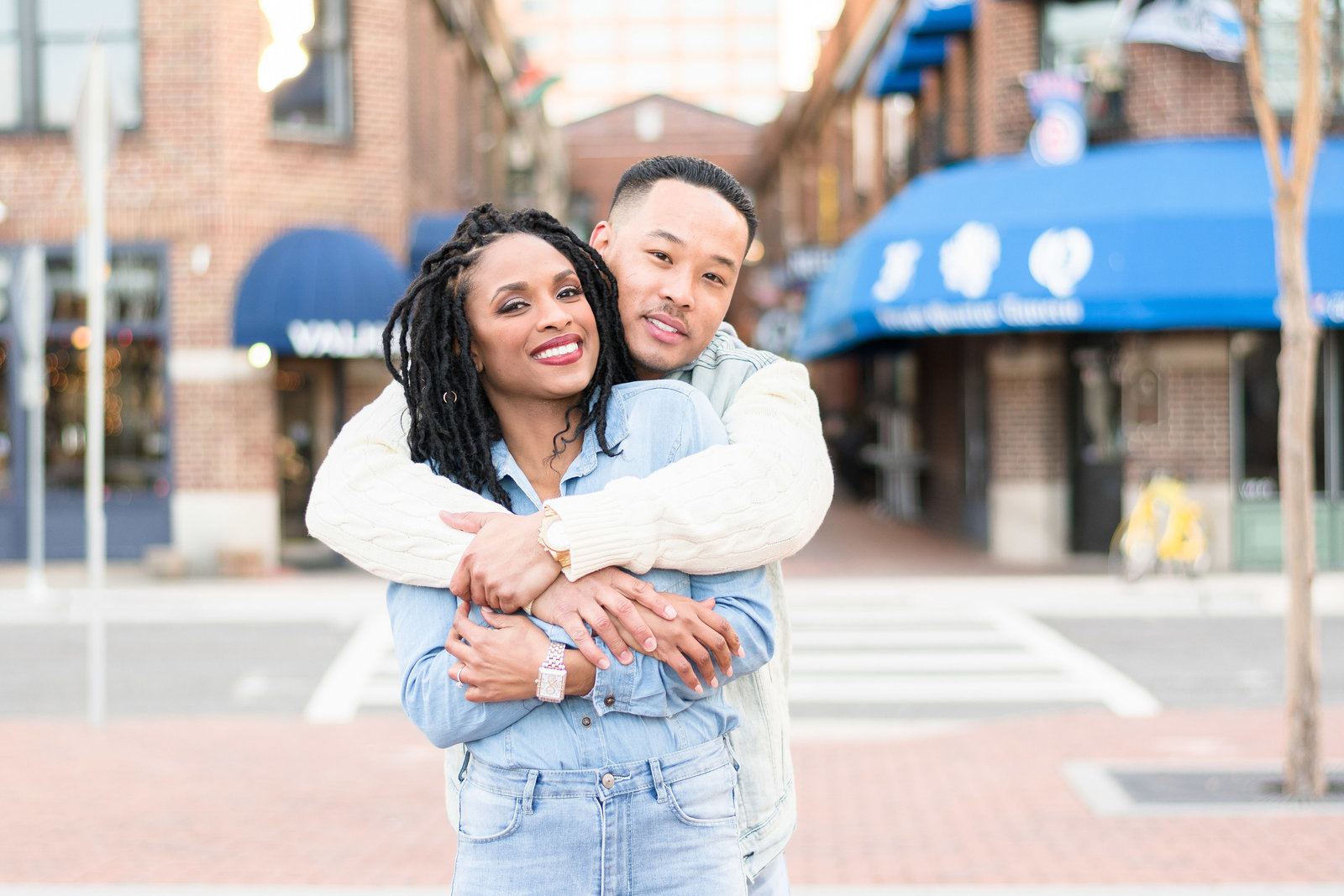 Charlotte engagement photographer shot of french quarter in uptown charlotte