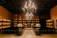 Amy and Alex had their indoor ceremony in Palm Event Center's Barrel Room .