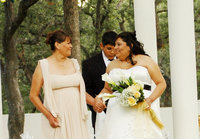 San Antonio Photographer Irene Castillo sitting walking down the aisle with her mother