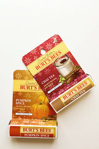 Two Burt's Bees packets laid out on a table.