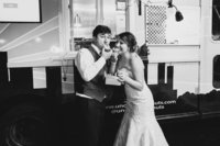 ashley and tyler eating donuts on their wedding day