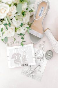 Wedding details portraits of the bride's Bouquet, Wedding Heels and jewelry flat lay
