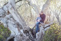 dad and toddler in a tree