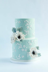 vintage blue wedding cake with lace and flowers