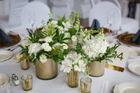 white and greenery wedding floral in gold containers