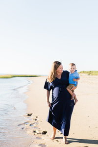 Mother and Toddler walking  on the beach in Cape Cod