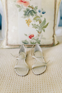 Bride's shoes on the bed in the bridal suite at Harmony Meadows