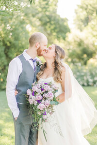 a bride and groom share a kiss at their sacramento backyard micro wedding