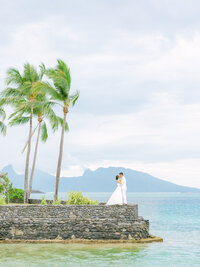 Bride and groom wide angle view, landscape from the intercontinental Tahiti