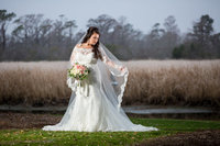 bridal portrait in front of the water at Caledonia