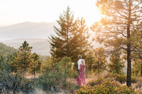 Couple holding hands and walking during sunset engagement session on top of Echo Ridge Trail