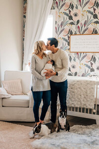 mom-and-dad-kissing-in-babys-room